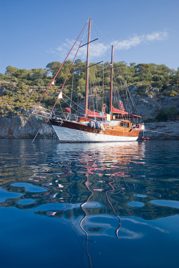 Turkish Gulet boat. A traditional Turkish gulet recreational boat anchored at a secluded bay in the Turkish Mediterranean royalty free stock photography