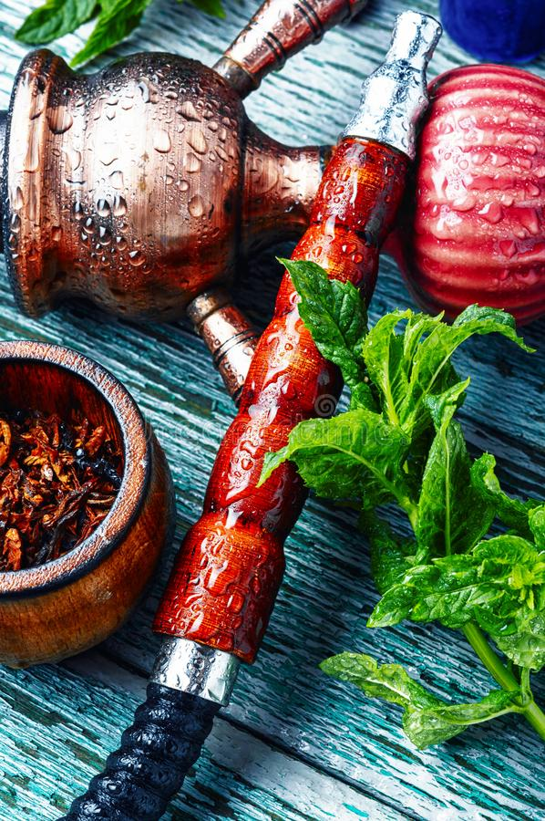 Turkish hookah with mint. East smoking hookah with mint flavor.Modern kalian with spearmint royalty free stock photos