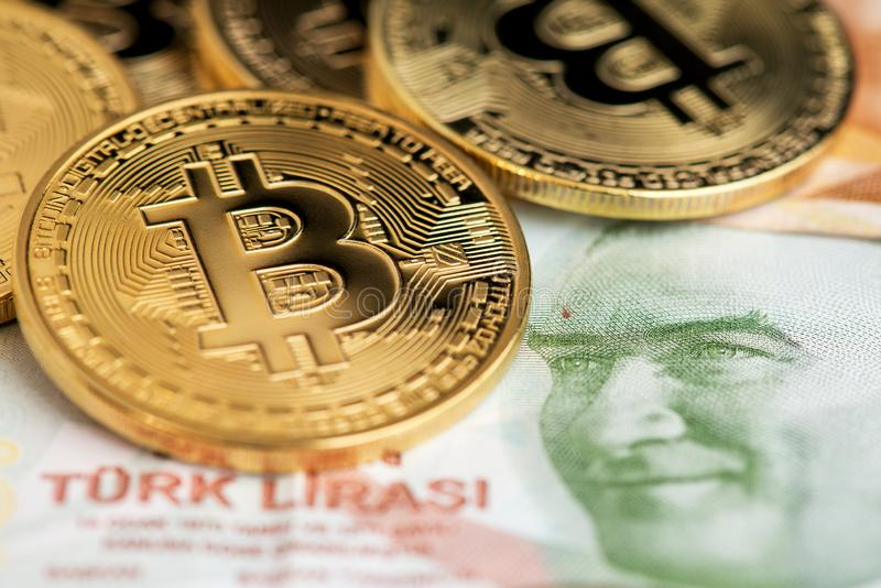 Turkish Lira banknotes and Bitcoin Cryptocurrency coins. royalty free stock photography