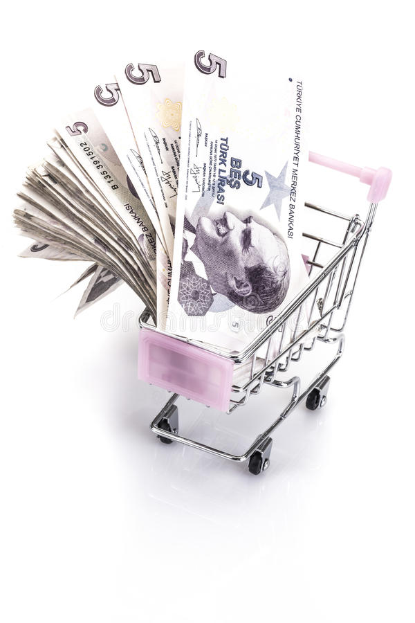 Turkish lira banknotes in a small trolley on white royalty free stock images