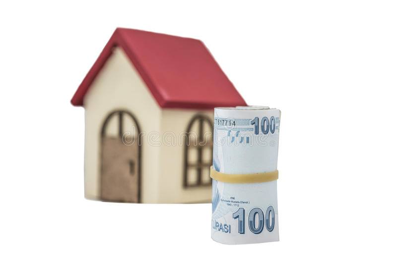 Turkish Lira banknotes and small wooden house. Isolated on white royalty free stock images