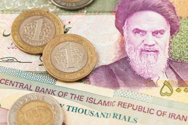 Turkish Lira Coins on Iranian Rial Currency Banknotes. Turkey Lira Iran Rial Money Oil stock image
