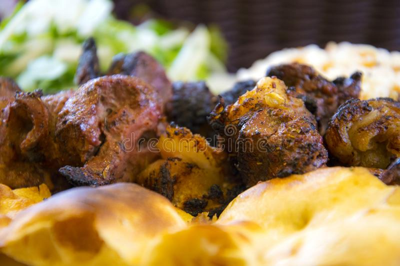 Turkish meat cooked in barbecue. With bread, salad, buttermilk and pepper stock photography