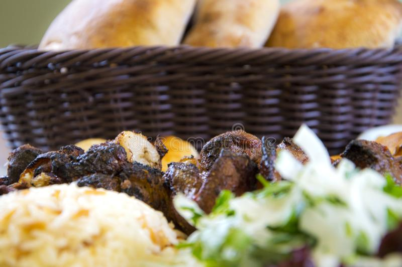 Turkish meat cooked in barbecue. With bread, salad, buttermilk ,rice and pepper stock photography