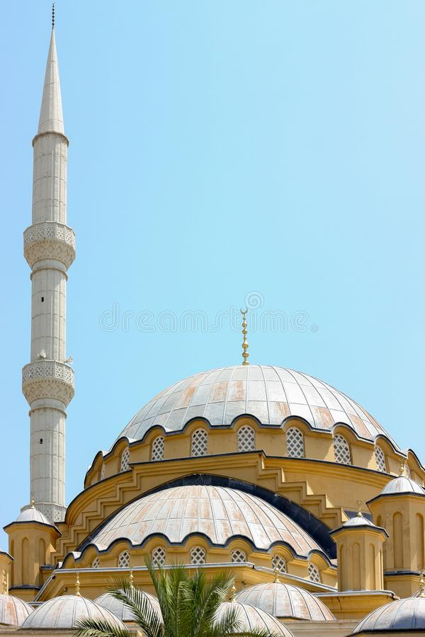 Turkish mosque on sky background. Vertically framed shot stock photography