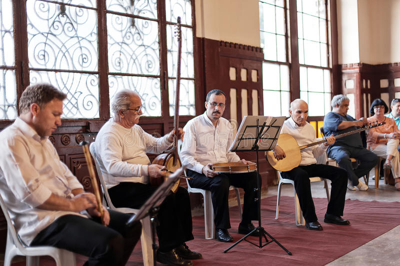 Turkish Musicians. ISTANBUL - April 29: Traditional Turkish music being performed with Whirling Dervishes of the Sufi Mevlevi Order at Serkeci Train Station on stock images
