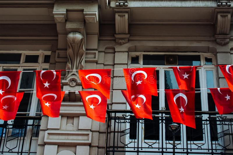 Turkish national flags with white star and moon. In sky royalty free stock photography