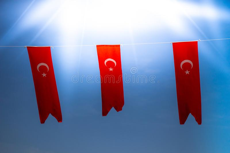 Turkish national flags with white star and moon. In sky stock photos