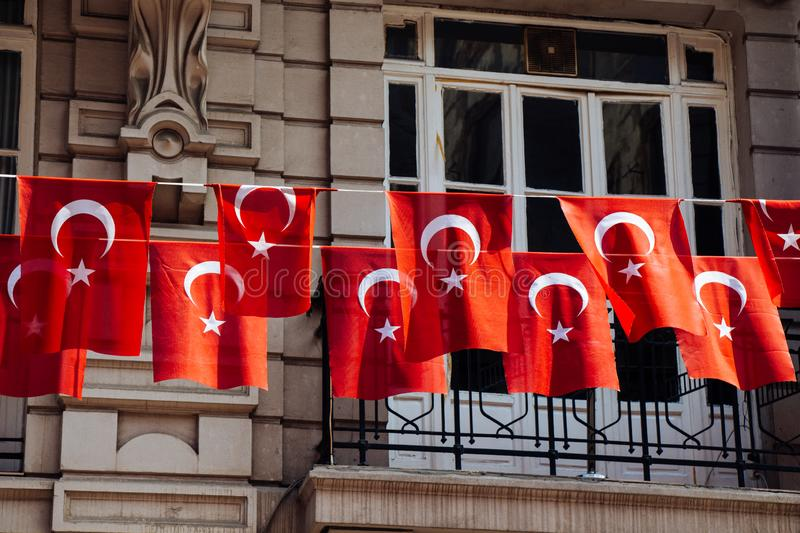 Turkish national flags with white star and moon. In sky royalty free stock photo
