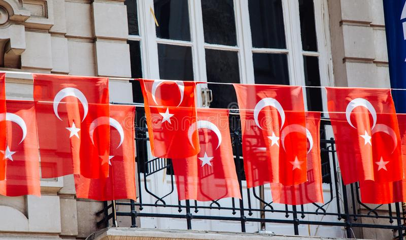 Turkish national flags with white star and moon in sky. Turkish national flags with white star and moon in the  sky royalty free stock photo