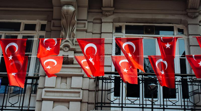 Turkish national flags with white star and moon in sky. Turkish national flags with a white star and moon in sky stock photo