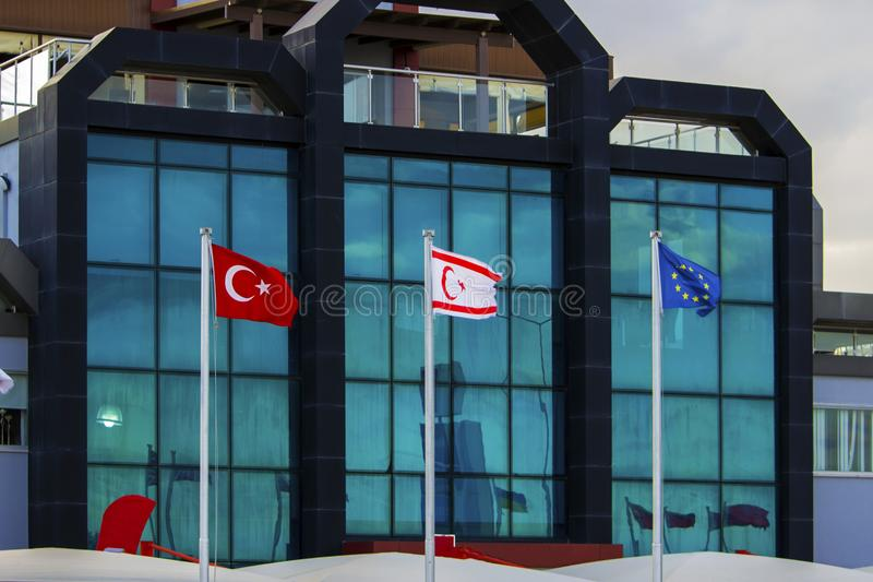 Turkish, Northern Cyprus and European Union flags. On glass building background stock image