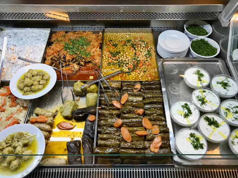 Turkish Olive Oil Food Dolma, Tzatziki Cacik, Chickpeas, Eggplant and Brussel Sprout at Showcase of Restaurant. Traditional Dish royalty free stock images