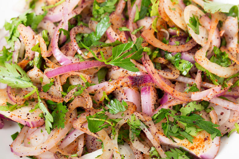 Turkish onion relish. Sogan piyazi, made with red onions, parsley, sumac and red pepper powder royalty free stock photo