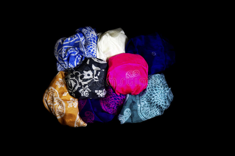 Turkish Oriental beautiful scarves with pictures of natural silk on a black background. Colorful Turkish Oriental beautiful scarves with pictures of natural silk stock photos