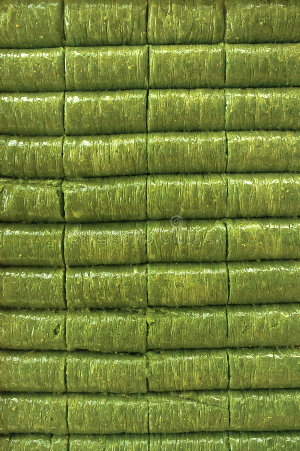 Turkish pistachio wrap baklava dessert fistik sarma fistik ezmesi. Close up for turkish pistachio wrap baklava dessert fistik sarma fistik ezmesi royalty free stock images