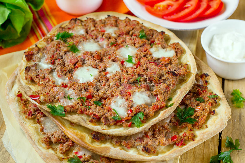 Turkish pizza Lahmajoun Lahmacun with ground beef stock image
