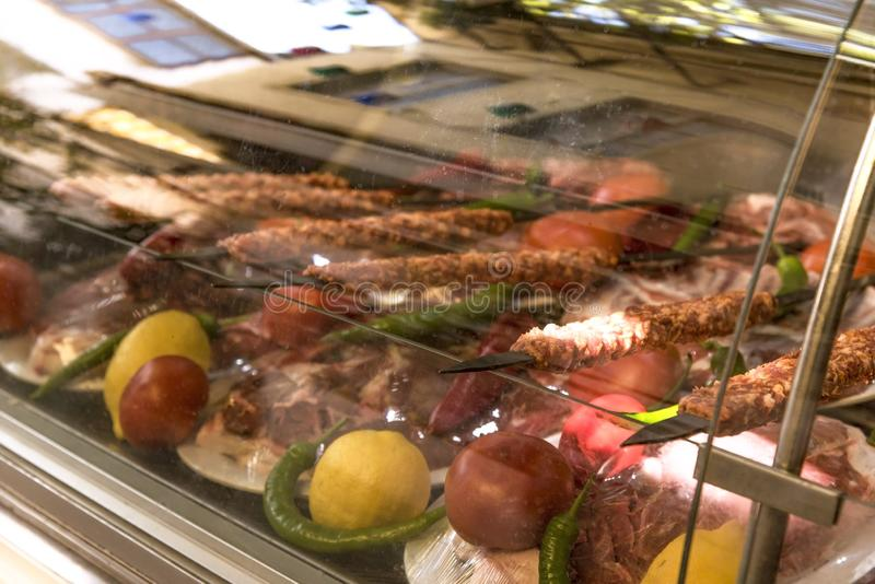 Turkish raw Adana kebab for serving in the deep freeze royalty free stock image