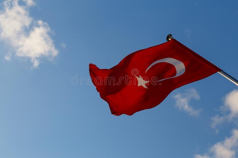 Turkish flag waving with wind on the sky royalty free stock photography