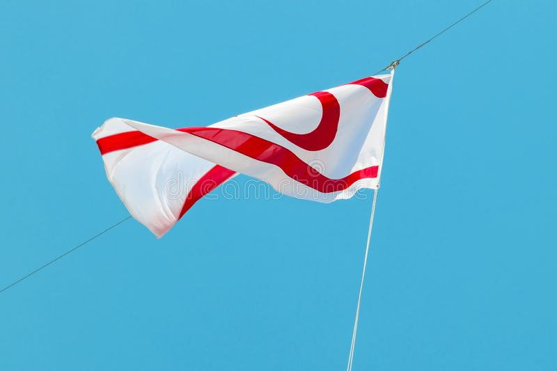 Turkish Republic of Northern Cyprus Flags is waving in blue sky.  stock photos