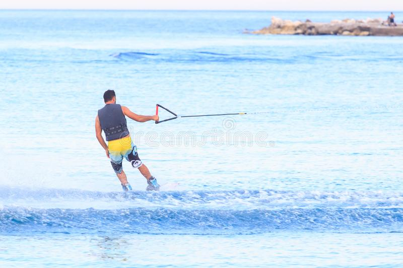 Turkish sportsman wakes himself on a wakeboard royalty free stock images