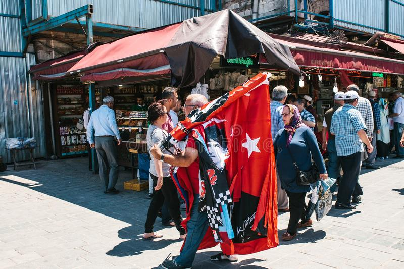 Istanbul, June 16, 2017: Turkish street fair - people sell tourist souvenirs in stalls, flags and snacks. Turkish street fair - people sell tourist souvenirs in stock image