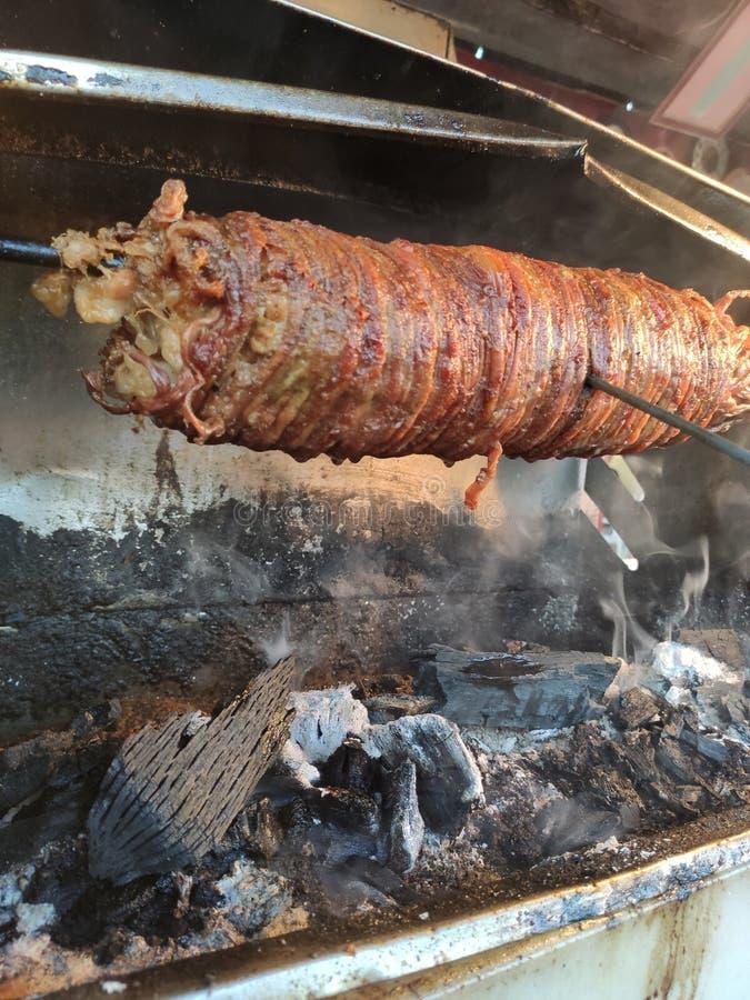 Turkish street food kokorec made with sheep bowel cooked in wood fired oven. Bursa Turkey royalty free stock photo