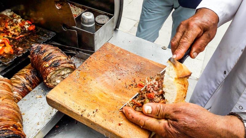 Turkish Street Food Kokorec made with sheep bowel. Traditional fast food royalty free stock image