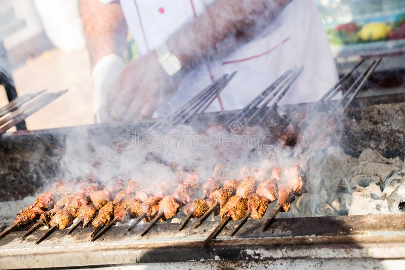 Turkish style meat shashlyk being grilled stock photo