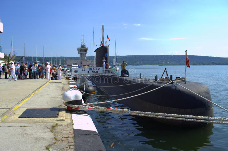 Turkish submarine moored at Varna port. People waiting to visit Turkish submarine Yildiray in open visiting hours.The submarine is among the participants in royalty free stock photo