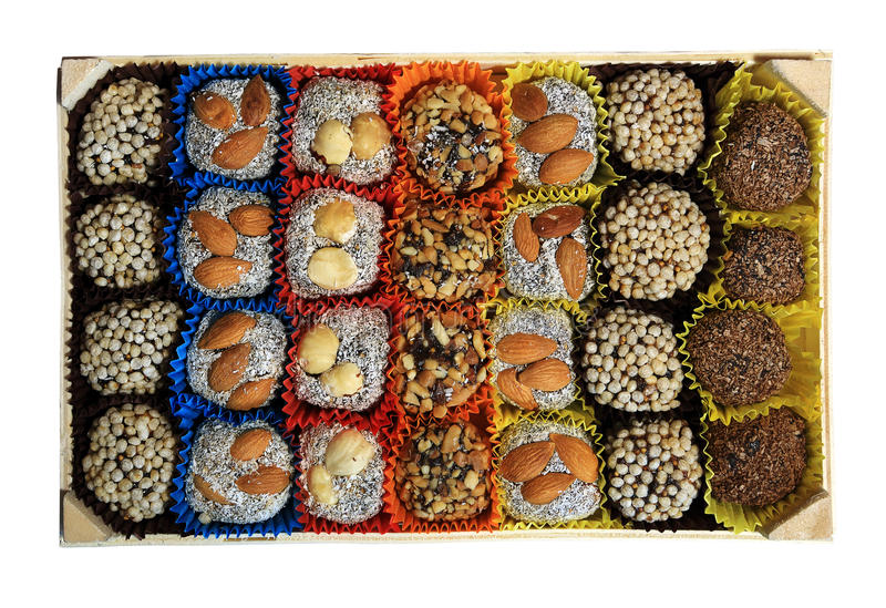 Turkish sweets, candies in a wooden box on the white background, isolated royalty free stock image