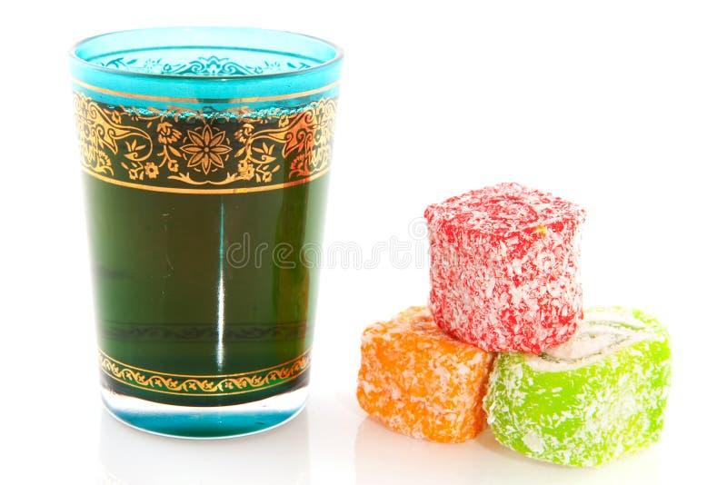 Turkish tea. Blue glass of Turkish tea with delight stock photo