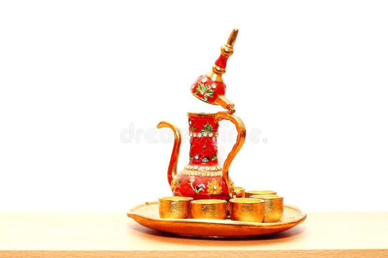 Turkish tea cups and pot. Turkish decorated tea set cups and pot stock image