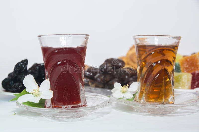 Turkish tea, Ramadan Food, Candy. Ramadan food on white background with turkish tea and candy royalty free stock images