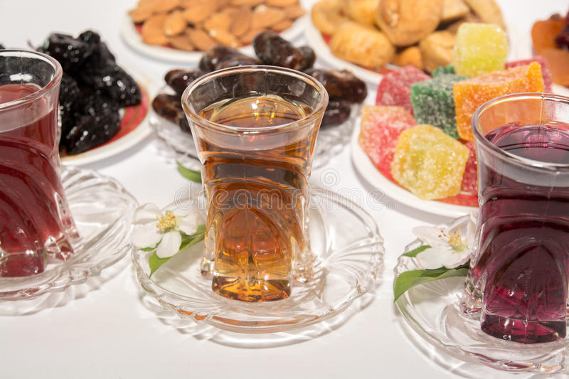 Turkish tea, Ramadan Food and Candy. Ramadan food on white background with turkish tea and candy stock photography