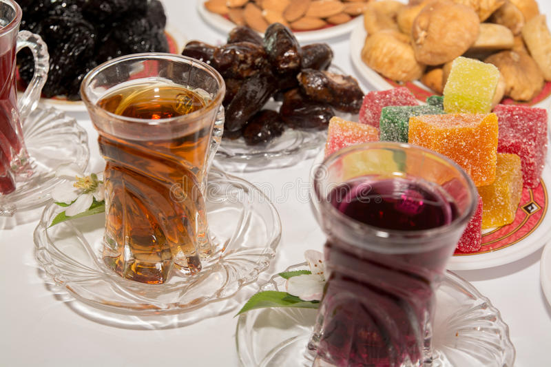 Turkish tea, Ramadan Food and Candy. Ramadan food on white background with turkish tea and candy royalty free stock image