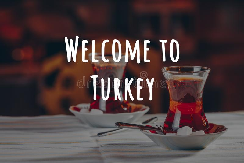 Turkish tea in the restaurant. Turkish cuisine and travel concept. Welcome to Turkey wording. Turkish tea in the restaurant. Turkish cuisine and travel concept stock photos