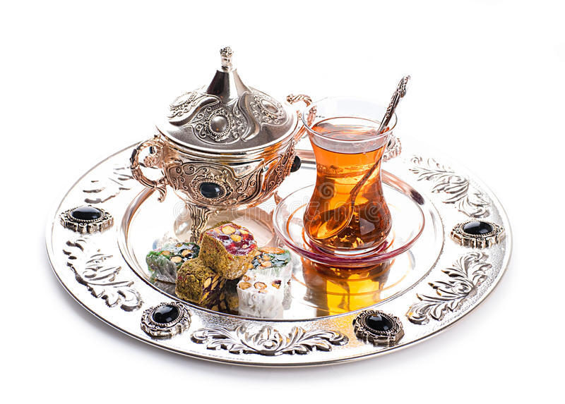 Turkish tea and sweets. In decorative ware, candies stock image