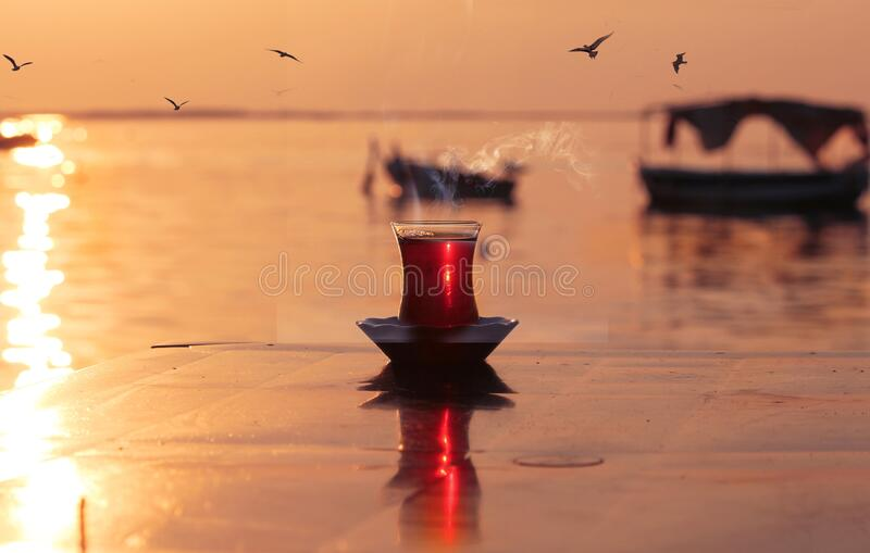 Turkish tea time with an amazing sunset view from izmir Turkey royalty free stock photos