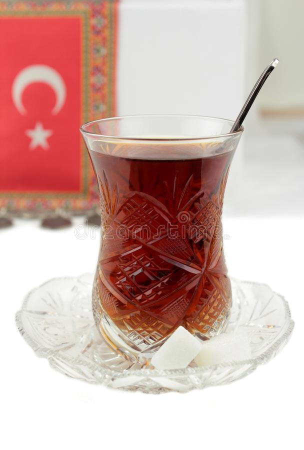 Turkish tea and traditional crystal tea glass. Turkish tea , traditional tea glass and turkish flag stock image