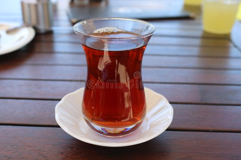 Turkish tea in traditional glass cup. stock photo