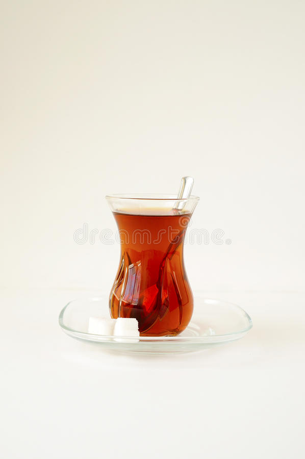Turkish tea in traditional glass. Turkish tea in traditional glass isolated on white background royalty free stock image