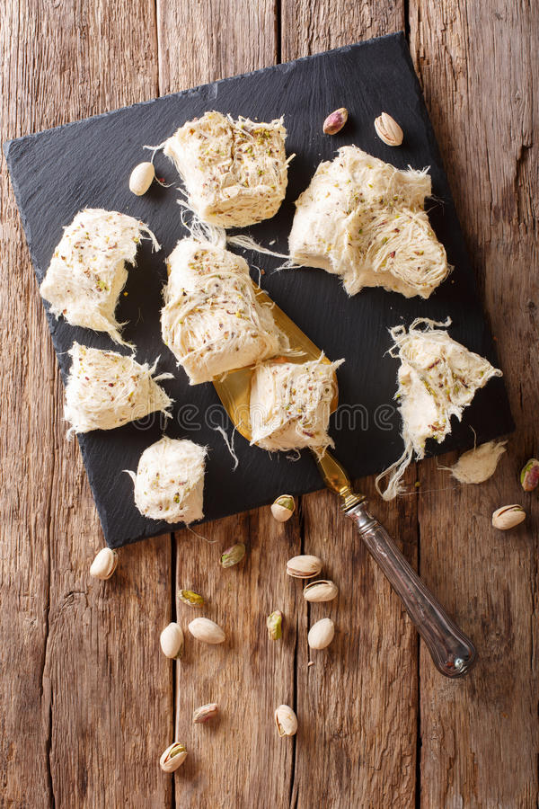 Turkish traditional dessert pismaniye with pistachios close-up o stock photography
