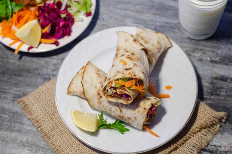 Turkish traditional foods; Lahmacun is on vintage table stock photo