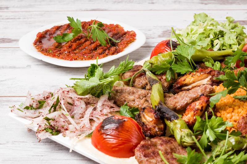 Turkish Traditional Mixed Kebab Plate with Adana and Chicken Kebabs royalty free stock images