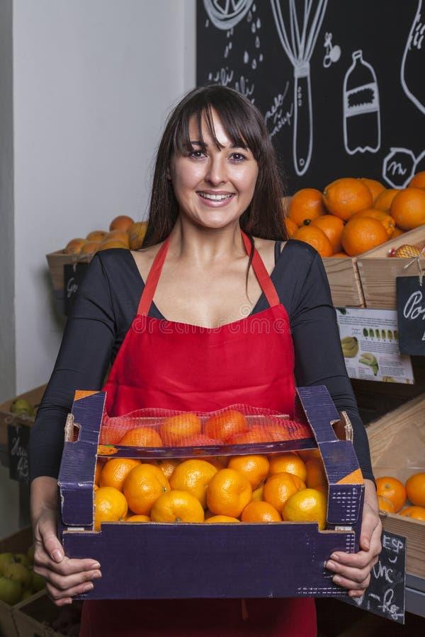 Turkish vendor at greengrocer stock images