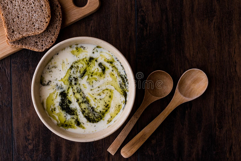 Turkish Yayla or Yogurt Soup with mint sauce Tzatziki. On a wooden surface stock photography