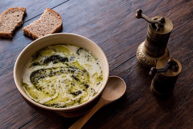 Turkish Yayla or Yogurt Soup with mint sauce Tzatziki. On a wooden surface stock photos