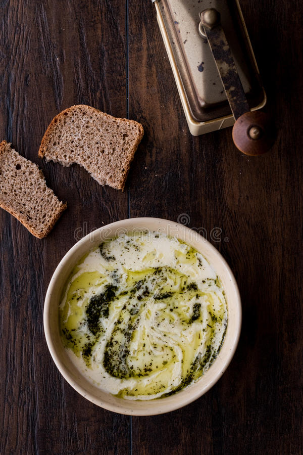 Turkish Yayla or Yogurt Soup with mint sauce Tzatziki. On a wooden surface royalty free stock image