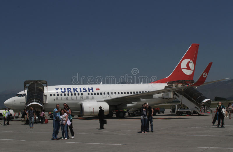 Turkisk Airlines - PODGORICA, MONTENEGRO. PODGORICA, MONTENEGRO - May 29, 2015: Turkisk Airlines, Airbus A320 waiting for boarding at Podgorica Airport (Aerodrom stock photography
